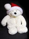 Teddy bear with christmas hat Stock Photos
