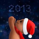 Teddy bear in Christmas hat. And scarf Stock Photos