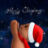 Teddy bear in Christmas hat Stock Images