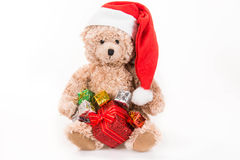 Teddy bear with christmas hat Stock Images