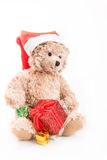 Teddy bear with christmas hat Stock Photos