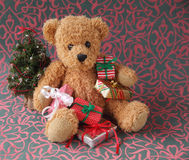 Teddy bear with Christmas presents Stock Photos