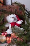 Teddy bear and christmas presents. Teddy bear in santa hat and christmas presents with decoratio royalty free stock image