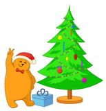 Teddy bear and Christmas tree Stock Photos