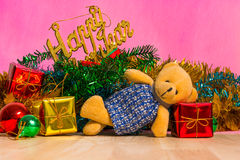Teddy bear and Christmas tree with presents on background Royalty Free Stock Photography