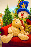 Teddy bear and christmas tree. Royalty Free Stock Photos