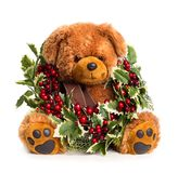 Teddy bear with Christmas wreath. Isolated on white background stock photo