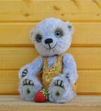Teddy-bear Chupa with strawberry Royalty Free Stock Photos