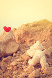 Teddy bear climbing a red heart with the goals. Teddy bear climbing a red heart with the goals vintage style Royalty Free Stock Image