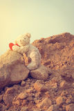 Teddy bear climbing a red heart with the goals. Teddy bear climbing a red heart with the goals vintage style Royalty Free Stock Photo