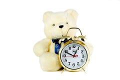 Teddy-bear and clock Stock Image