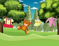 A teddy bear and clothes hanging Royalty Free Stock Images