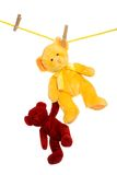 Teddy bear on clothes line rescuing another Stock Photo