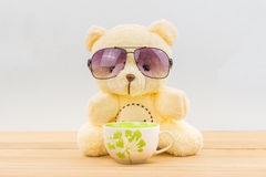 Teddy bear and coffee cup Royalty Free Stock Image