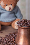 Teddy bear coffee pot and beans still life Royalty Free Stock Photo