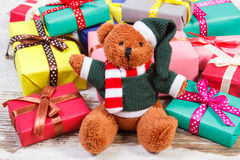 Teddy bear with colorful gifts for Christmas or other celebration Royalty Free Stock Image