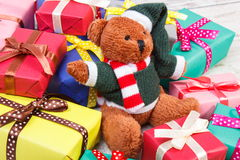 Teddy bear with colorful gifts for Christmas or other celebration Stock Photography
