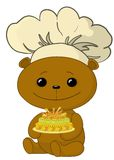 Teddy bear cook with cake Royalty Free Stock Photos