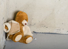 Teddy bear in corner Stock Photo