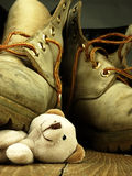 Teddy bear crushed by a heavy, old military boot. Royalty Free Stock Photography