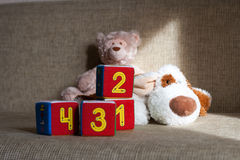 Teddy bear and cubes with number Royalty Free Stock Photos