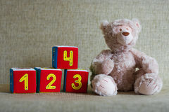 Teddy bear and cubes with number Royalty Free Stock Images