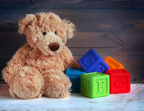 Teddy bear and cubes Stock Image