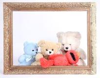 Teddy bear. Cute teddy bears sitting behind old wooden frame Stock Photos