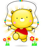 Teddy bear cute playing rope in sunshine.  Royalty Free Stock Images