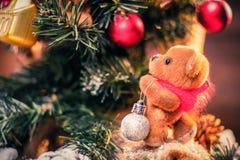 Teddy bear decorating tree Royalty Free Stock Image