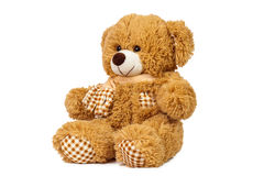 Teddy bear. Deployed towards on a white background royalty free stock photography