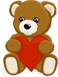Teddy Bear, der ein Herz hält Lizenzfreie Stockfotos