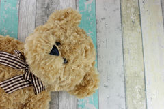 Teddy bear on a distressed wood background. Royalty Free Stock Image