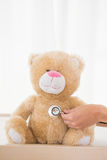 Teddy bear with doctor and stethoscope Royalty Free Stock Photos
