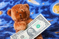 Teddy bear and dollars Royalty Free Stock Images