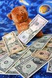 Teddy bear and dollars stock photography