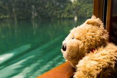 Teddy bear in boat on Konigsee lake in Germany. Teddy bear Dranik in boat on Konigsee lake in Germany royalty free stock photo