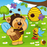 Teddy bear dressed as bee goes for honey Royalty Free Stock Photos