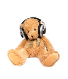 Teddy bear with ear-phones. Isolated on the white Stock Image