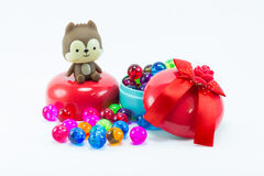 Teddy bear, eddy cat on red blue gift box. Royalty Free Stock Images