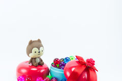 Teddy bear, eddy cat on red blue gift box. Royalty Free Stock Photo