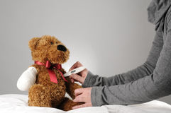 Teddy bear examination Royalty Free Stock Image