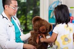 Teddy bear during examination Royalty Free Stock Image