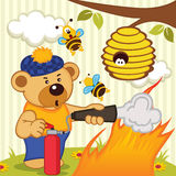 Teddy bear extinguishes fire Stock Image