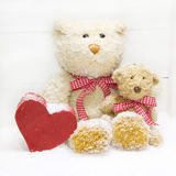 Teddy bear family - mother with child and red heart of wood for Royalty Free Stock Photo