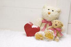 Teddy bear family - mother with child and red heart of wood for Royalty Free Stock Image