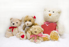 Teddy bear family - mother with children and red heart of wood f Royalty Free Stock Photography