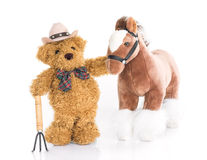 Teddy bear farmer with pitchfork  and horse. Teddy bear Royalty Free Stock Image