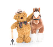 Teddy bear farmer with pitchfork  and horse Stock Images