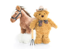 Teddy bear farmer with pitchfork  and horse. Teddy bear Royalty Free Stock Photo